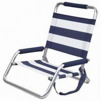 Low profile sand beach chair made of distressed coating and beautiful