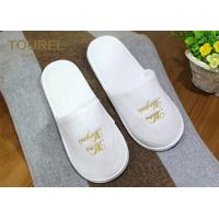 China One Size Fits Most Coral Fleece Disposable Hotel Slippers with Various Logo Choices on sale
