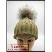 China Red Knitted Fashion Cheap Winter Hats Raccoon Fur Ball Hats for Women on sale