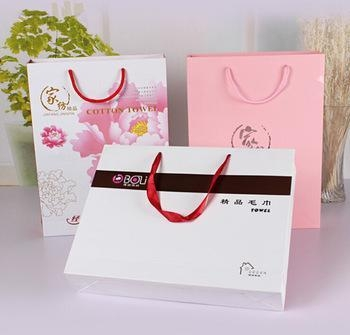 Buy White matt gift paper bags with black hot foil stamping at wholesale prices